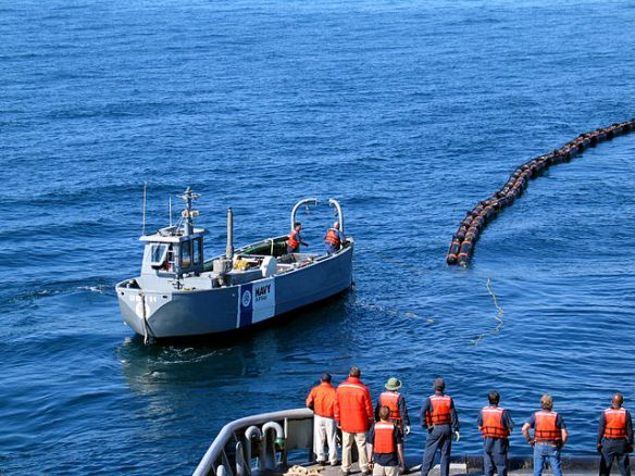 """Spill response crews practiced dealing with a simulated 90,000 barrel spill during crude oil loading at the Valdez terminal."" (Photo Credit: US NAVY)"