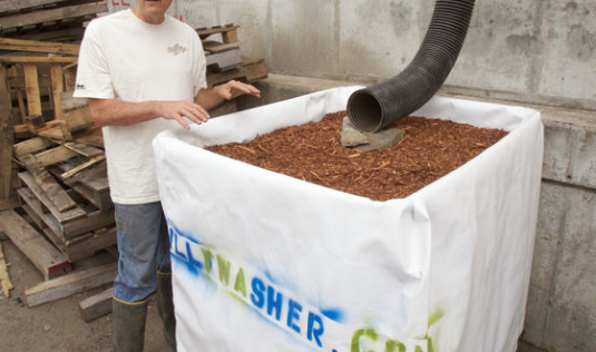Rainwater compost filter boxes remove zinc and copper contaminates before water flows into the river. (Photo Credit: Doug Beghtel, The Oregonian)