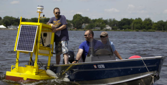 John Hernandez, PHD student at University of Wisconsin-Milwaukee, approaches the spot on Lake Winnebago to anchor the in-house designed buoy. (Photo Credit: Milwaukee Journal Sentinel)