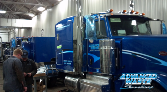Liquid Waste Hauler trucks in maintenance bay.