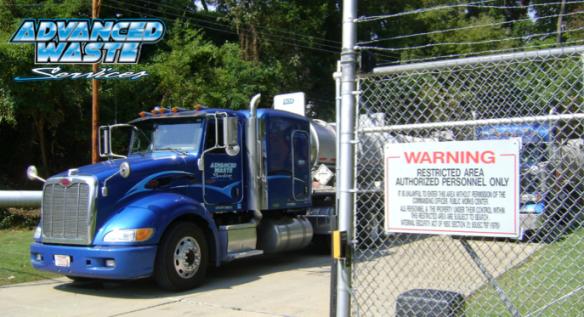 Vacuum Truck behind secured fence