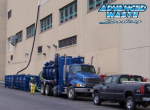 Above two vac boxes and a high-powered vacuum truck keep a sludge removal project on time and within budget.